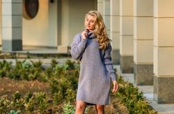 Enjoy softness. Blonde girl make up face fall outfit. Knitwear concept. Cashmere woolen sweater. Warm oversized sweater. Woman wear sweater. Elongated sweatshirt tunic dress. Free style comfortable.