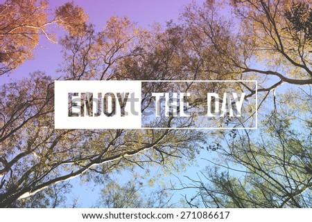 Enjoy the day motivational inspiration quote concept tree landscape. Soft light color hipster style ideal for print card and poster design.