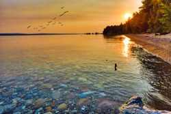 Enjoy the view of Lake Michigan during sunrise and sunset.  This view is between Petoskey and Charlevoix Michigan.