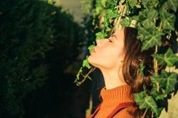 Enjoy warmth. Woman enjoy sunny day outdoors. Autumn season concept. Pretty woman sun tanning nature background. Fashion concept. Catch last beams of sunlight. Warmth and sunlight. Feeling warmth.