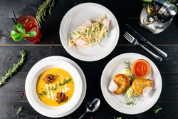 Enjoy your meal. Set of three delicious dishes served on a restaurant table, full set of three dishes for lunch in a cafe