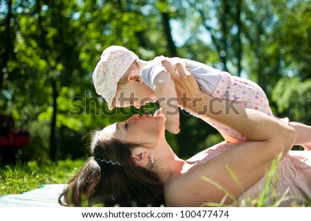 Enjoying life - happy mother with child