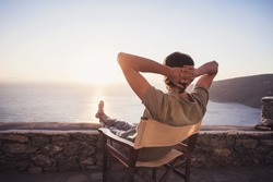 Enjoying life. Young man looking at the sea, relaxation, vacations, holidays, travel, summer fun, active lifestyle concept.