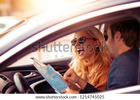 Enjoying road trip together.Leisure, road trip,people and travel concept -man and woman driving in car. #1214745025
