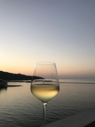 enjoying white wine glass with a spectacular view