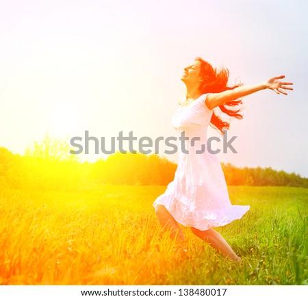 Enjoyment. Free Happy Woman Enjoying Nature. Beauty Girl Outdoor. Freedom Concept. Beauty Girl Over Sun