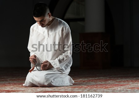 Enlightenment Young Muslim Man Making Traditional Prayer To God While Wearing A Traditional Cap Dishdasha