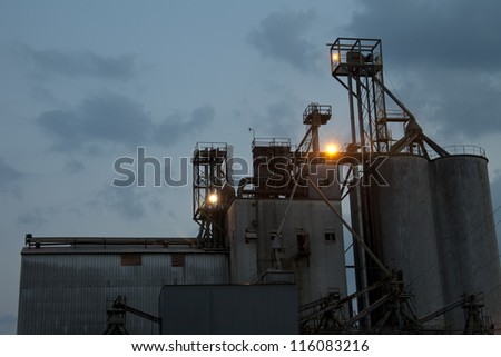 Enormous industrial building backed with a cloudy night sky