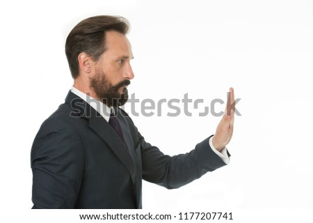 Enough tolerating unacceptable behavior. Hold on. Man shows hand palm gesture to stop isolated on white. Man bearded mature in formal wear. Businessman manager with beard mustache shows stop gesture.