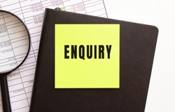 ENQUIRY text on a sticker on your desktop. Diary and magnifier. Financial concept.