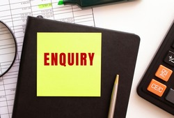 ENQUIRY text on a sticker on your desktop. Diary, calculator and pen. Financial concept.
