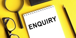 ENQUIRY word written on notepad. ENQUIRY text on table for your desing
