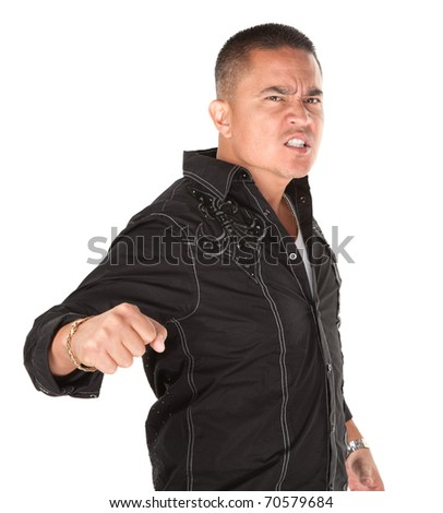 Enraged Hispanic man with fist on white background