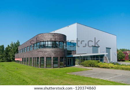 ENSCHEDE, NETHERLANDS - JULY 25: Modern office building on july 25, 2012 in Enschede, Netherlands. Located in the Business & Science park, a mix of companies stimulated by the University of Twente.