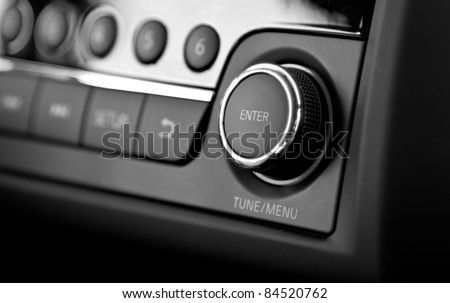 Enter button and knob on a car's dashboard