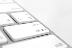 Enter button close up an soft focus keyboard computer with gray color