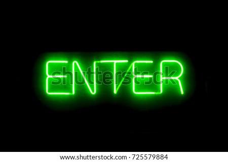 Enter neon illuminated sign on the garage entrance