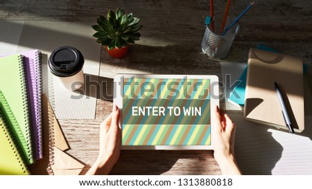 Enter to win text on the screen. Giveaway. Lottery and prizes. Social media marketing and advertising concept. #1313880818