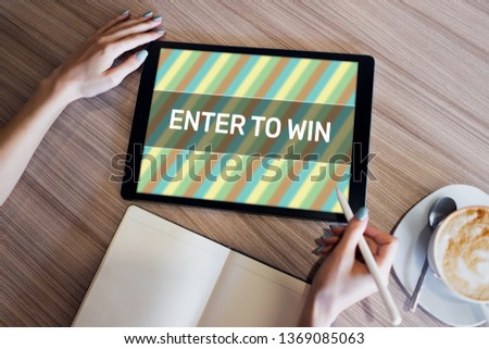 Enter to win text on the screen. Giveaway. Lottery and prizes. Social media marketing and advertising concept. #1369085063