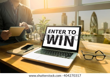 ENTER TO WIN Thoughtful male person looking to the digital tablet screen, laptop screen,Silhouette and filter sun #404270317