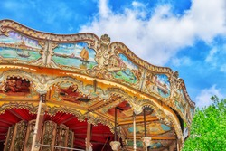 Entertainment Carousel for the youngest children. Horses on a carnival.