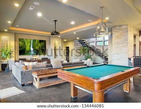 Entertainment Room in Luxury Home with Movie Screen and Pool Table - stock photo