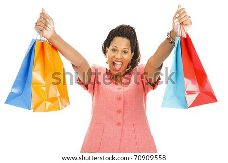 Enthusiastic african-american woman holding up her shopping bags.  Isolated on white.