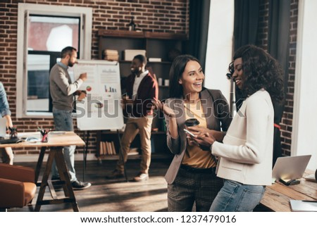 enthusiastic casual businesspeople working together in loft office
