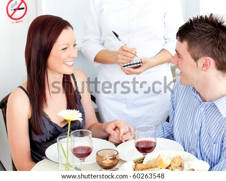 Enthusiastic couple dining at the restaurant