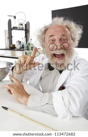 Enthusiastic eccentric senior scientist in his lab, pointing up and excited about his ideas. High key, vertical, copy space.