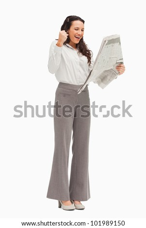 Enthusiastic employee reading the news against white background
