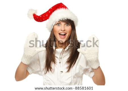 Enthusiastic girl in Santa hat shouting Xmas news, isolated on white background - stock photo