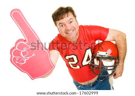 Enthusiastic middle aged football fan wearing his old high school jersey and holding a helmet and a foam finger.  Isolated on white.