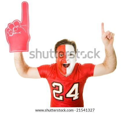 Enthusiastic sports fan with foam finger raises his arms in the Number One gesture.  Isolated on whit.