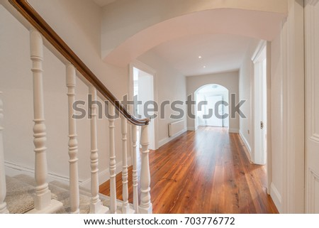 Entrance and a hallway in a house #703776772