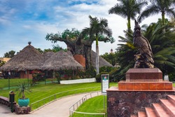 Entrance, decorated with sculprure of parrpt at Loro park on Tenerife island, Spain