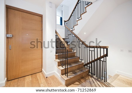 entrance door and modern staircase with a nice wooden finish