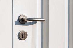 Entrance door handle close up. Lock and handle on the door.