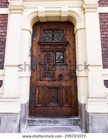 entrance door in front of residential house.  wooden door