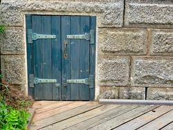 Entrance door leading to old underground cellar