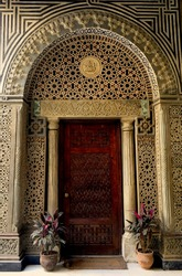 Entrance door of a church in Old Cairo with arabesque stonework
