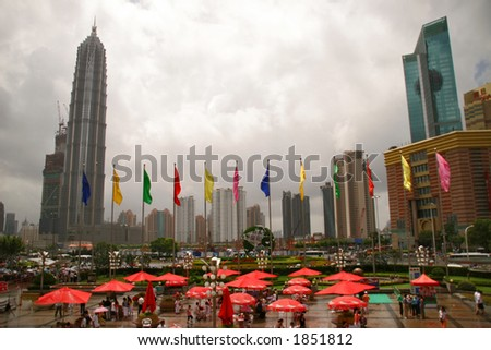 entrance flags to Oriental Pearl TV Tower in Shanghai with Jinmao Tower in background