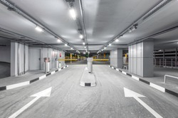 Entrance gate to underground garage parking. Automobile parking inside.