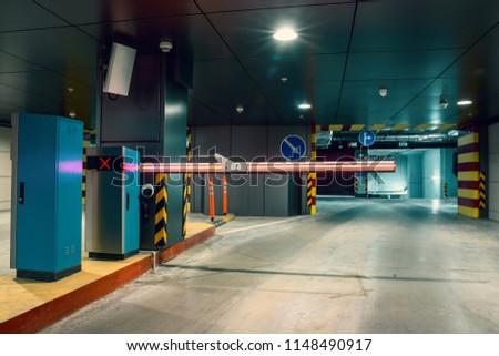 Entrance gate to underground garage parking lot, auto park interior inside, toned #1148490917