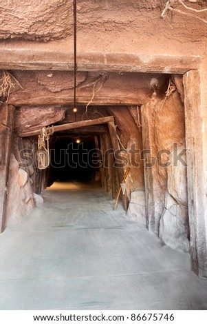 Entrance into the darkness of a mine.