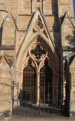 Entrance of a church,  some of the sandstone requiring restoration. Hunter Baillie Memorial Presbyterian Church a heritage listed church built 1889. An example of Gothic Revival architecture.
