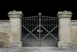entrance of a graveyard with a closed wrought-iron gate in dark gradient back
