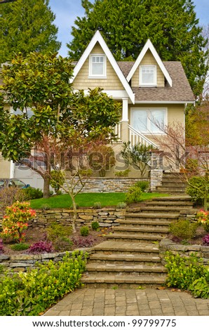 Entrance of a house with gorgeous outdoor landscape