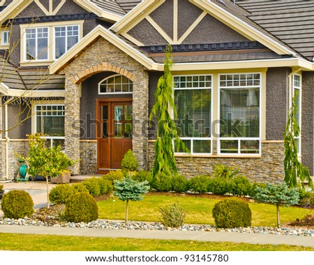 Entrance of a house with nice outdoor landscape