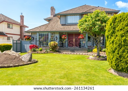 Entrance of a luxury house with a patio on a bright, sunny day. Home exterior.